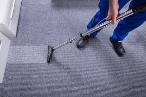 bigstock-janitor-cleaning-carpet-234805855