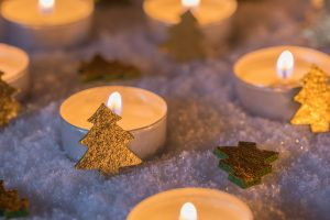 Advent And Christmas Mood With Candles And Golden Christmas Tree